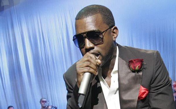 Kanye posts photos of his record deal amid dispute